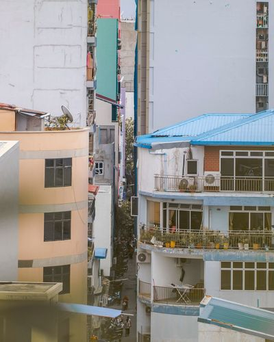 Colorful blocks of concrete. MALE' city, is the most dense populated city. Built Structure Day Outdoors Apartment Balcony Roof High Angle View Nature House Sky Water
