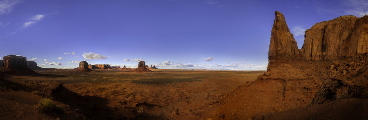 Scenic Monument Valley, part of the Navaho Nation in Arizona. Monument Valley Tribal Park Navajo Nation Park Beauty In Nature Landmarks Movie Sets Mountains Scenic View Landscape Photography Adventure Travel Travel Photography Nature Nature Photography Outdoors Outdoor Photography Rock Formation Rocks Sky Clouds Colors Panaramic View