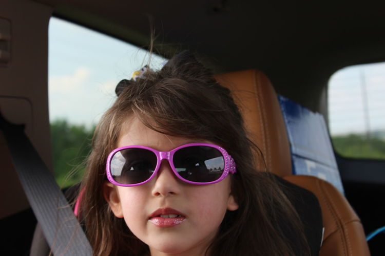 On our way to thank the disaster response troops and volunteer after Hurricane Harvey. Pink Car Child Childhood Close-up Day Focus On Foreground Girls Headshot In The Car One Person Outdoors People Real People Sky Sunglasses Transportation