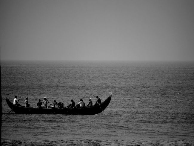 Fishing:not just a passion.. Transportation Real People People Men Nature Outdoors Sea Beauty In Nature Water Day Teamwork Sky Monochrome Photography Freshness Kerala Gods Own Country Beach Hope Shankumugham Random Shots The Way Forward Fishermen's Life Fisherman Boat Live For The Story