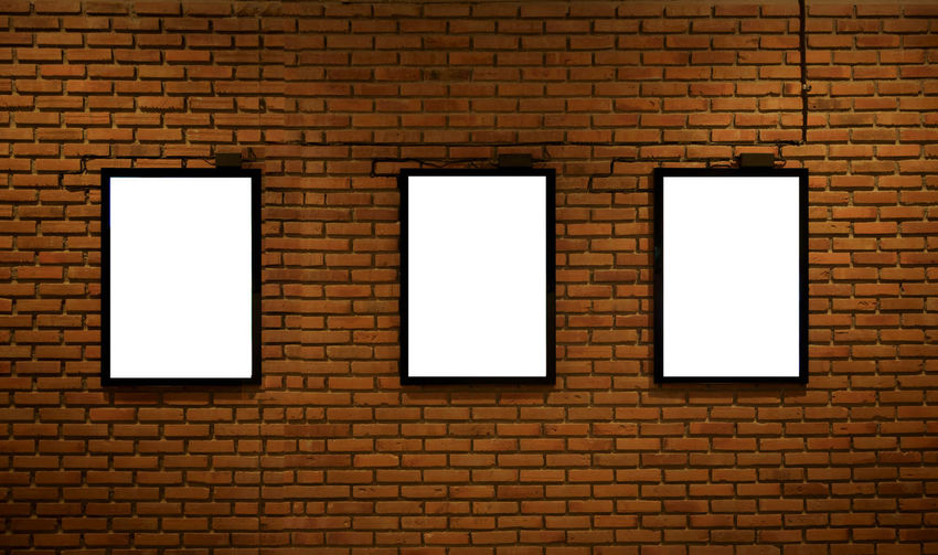 Abstract Advertisement Architecture Arrangement Backgrounds Billboard Blank Brick Brick Wall Built Structure Copy Space Full Frame Illuminated In A Row Painted Image Paper Pattern Photograph Picture Frame Poster Rough Textured  Wall - Building Feature White Color Window