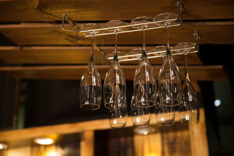 Low angle view of champagne flute hanging at bar