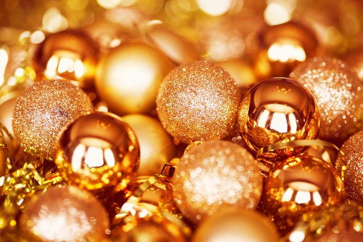 Full frame shot of golden baubles