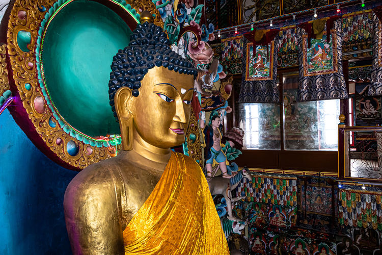 Statue of buddha in temple outside building
