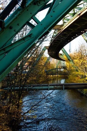 Nordbahntrasse EyeEm Best Shots EyeEm Selects EyeEm Gallery Tree Architecture Water Built Structure Plant No People Day Bridge - Man Made Structure Pattern Building Exterior Reflection Outdoors Nature Low Angle View Bridge Connection Metal River Sky Ceiling