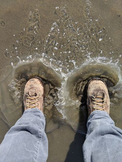 Low Section Water Men Human Leg Standing Wet Shoe Personal Perspective Directly Above Close-up Puddle