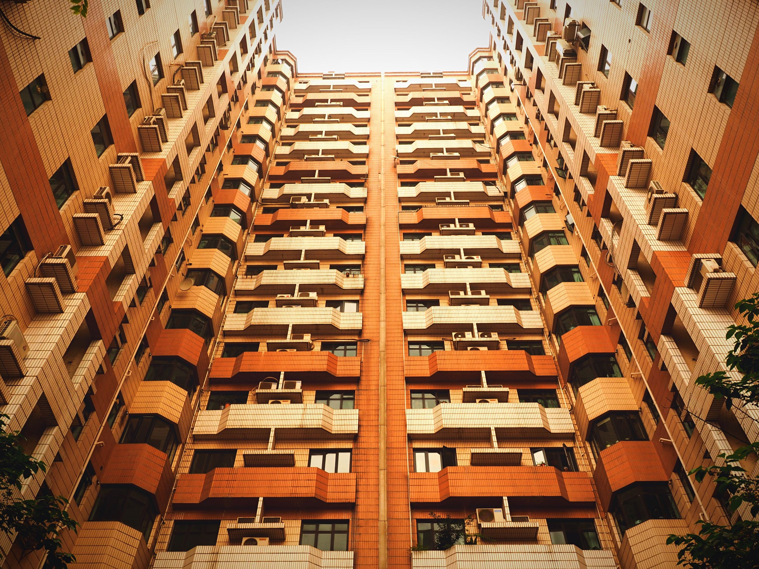 architecture, building exterior, built structure, low angle view, residential building, city, building, in a row, residential structure, window, repetition, office building, modern, roof, apartment, full frame, day, outdoors, clear sky, no people
