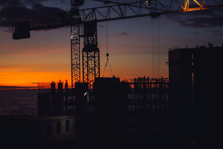 Sunset Sky Silhouette Industry Orange Color Water Architecture Nature No People Machinery Cloud - Sky Sea Built Structure Outdoors Construction Industry Crane - Construction Machinery Development Construction Site Pier