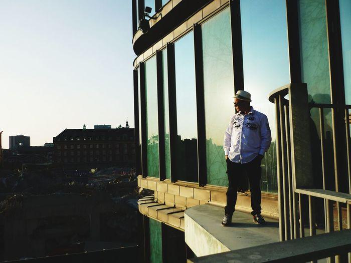 Full length of man standing by railing against sky