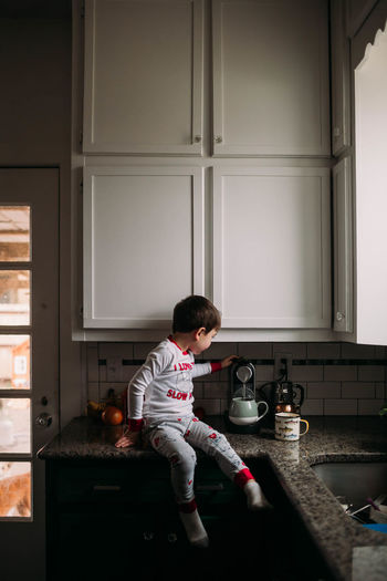 Boy playing by window at home