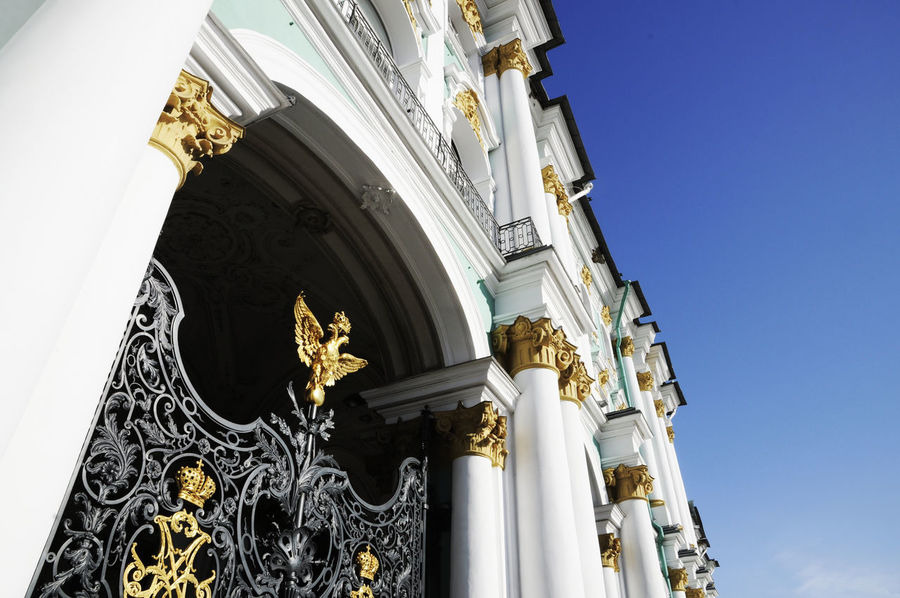 The Winter Palace Gates in St. Petersburg Arch Architectural Column Architectural Feature Architecture Building Exterior Built Structure Capital Cities  Clear Sky Column Day Eagle Eremitage St. Petersburg Famous Place Gate History Imperial Imperial Palace Low Angle View No People Ornate Portal Revolution St. Petersburg, Russia Travel Destinations Winter Palace