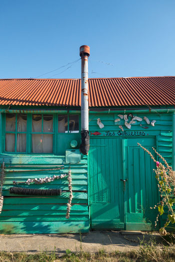 House Hut Wooden Wood - Material Old Fishermanvillage Built Structure Tradtional Clear Sky Blue Sky Architecture Green Color Built Structure Corrugated Iron Worn Out Bad Condition Weathered Shutter Rusty Turquoise Colored Peeling Off Civilization Damaged