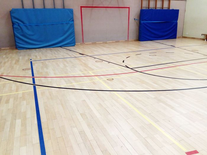gym sports center playing field parquet Gym Sports Center Parquet Wooden Paneling Goal Indoor Sports Ball Sports Playing Field Field Line Field Limit Limit Line No People Indoors  Blue Day Close-up