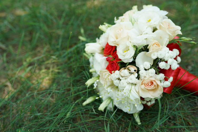 Close-up of rose bouquet on field