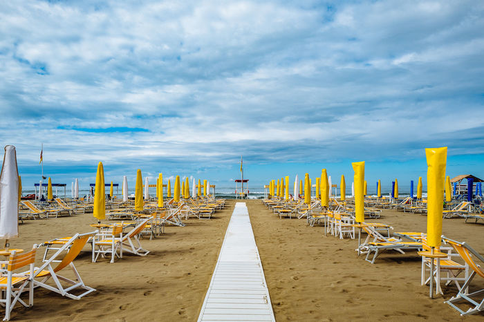Camaiore Tuscany Beach Beauty In Nature Cloud - Sky Day Horizon Over Water In A Row Italy Nature No People Outdoors Sand Scenics Sea Sky Tranquil Scene Tranquility Vacations Water Paint The Town Yellow