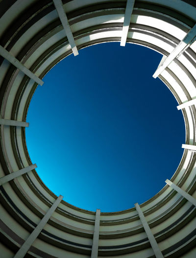 Low angle view of skylight against clear blue sky