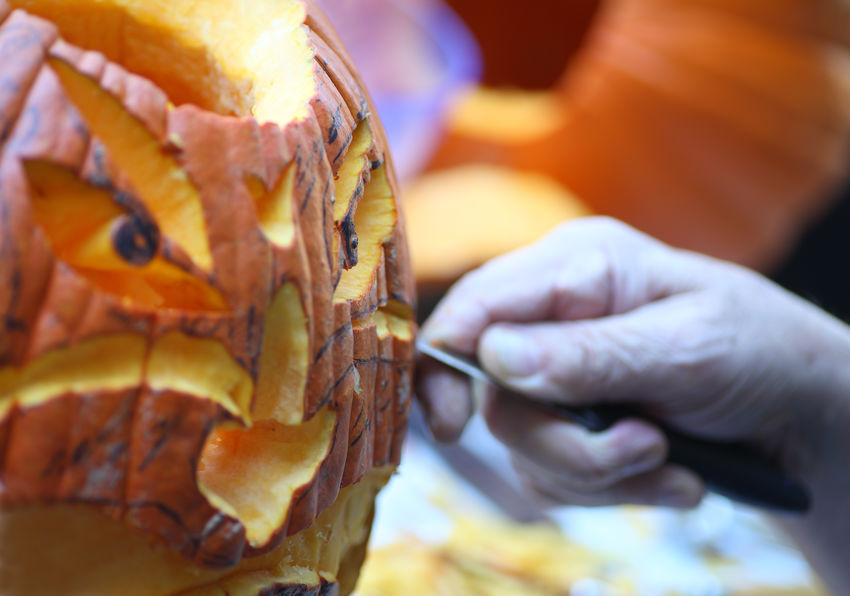 Carving a complex jack o' lantern American Culture Autumn Carving Close-up Craft Creativity Creativity Face Fall Fingers Halloween Hand Holiday Tradition Jack O' Lantern Man Natural Light October One Person Orange-colored Outdoors Pumpkins Senior Using Tool