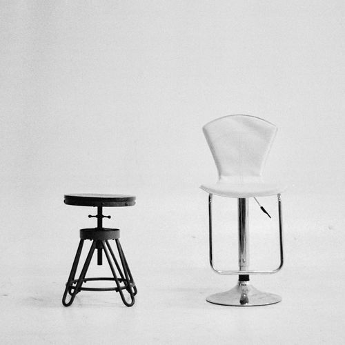 Close-up of empty chair on table against white background