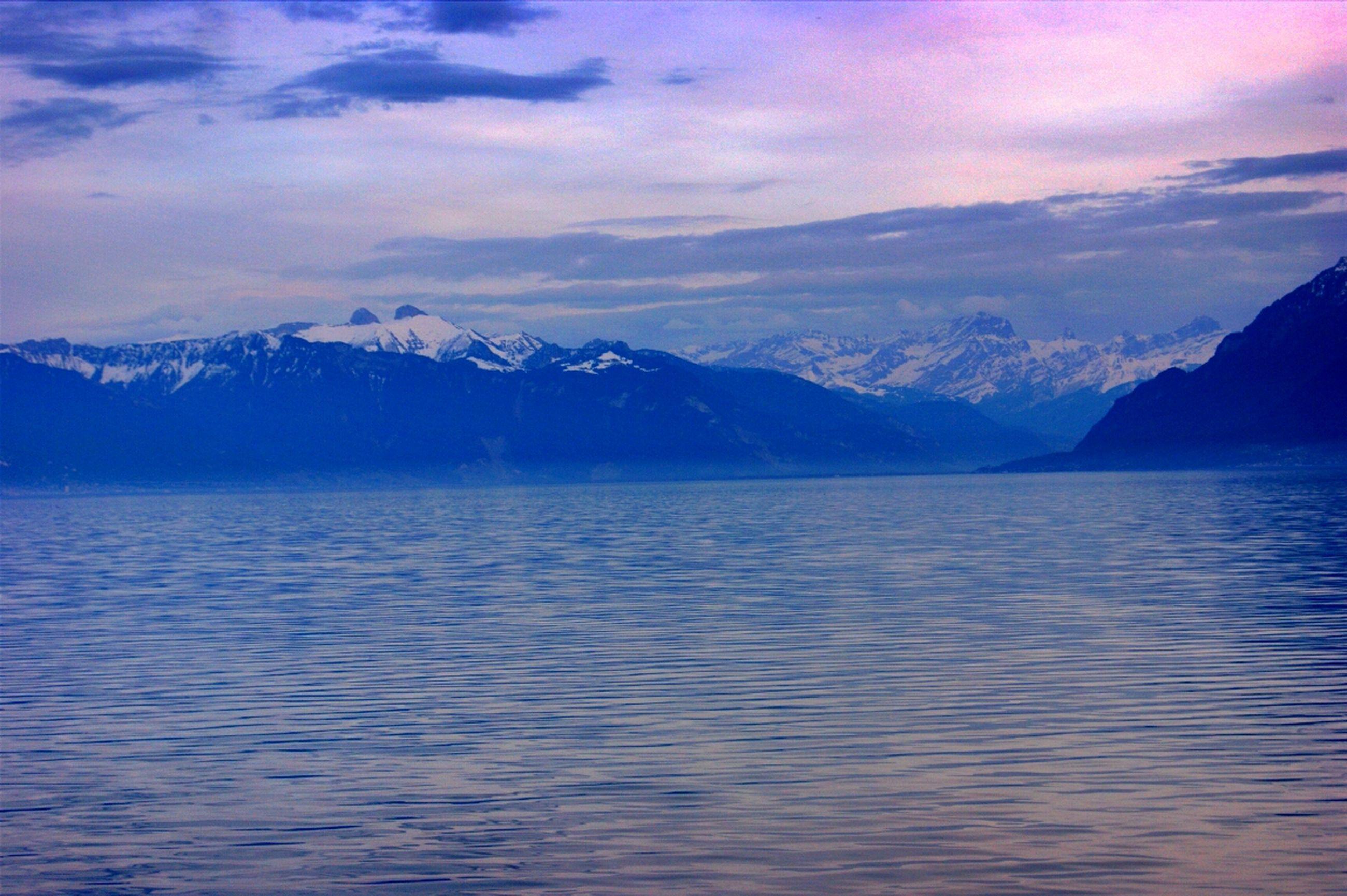 mountain, tranquil scene, scenics, mountain range, tranquility, water, beauty in nature, waterfront, sky, lake, nature, cloud - sky, idyllic, rippled, winter, cold temperature, cloud, snow, snowcapped mountain, non-urban scene