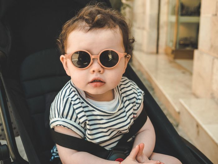 Baby with sunglasses Beauty EyeEm EyeEm Best Edits Eyeemphotography depth of field Eyeemphotography EyeEm Selects EyeEmNewHere Stroller Outdoors Child Childhood Real People One Person Portrait Innocence Baby Young Looking At Camera Cute Lifestyles Babyhood Sunglasses Casual Clothing Toddler