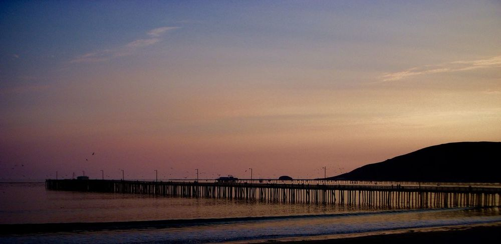 Avila Beach CA Avila Pier Beauty In Nature Birds Flying Over Water Central Californinia Coastal Beauty Coastline Dusk Nature No People Outdoors Scenics Sea Silhouette Sky Sunset Tranquil Scene Tranquility Water Landscape Photography Evening Sky
