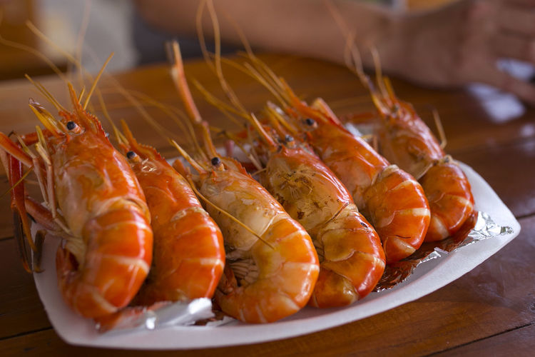 Close-up of prawns in plate on table