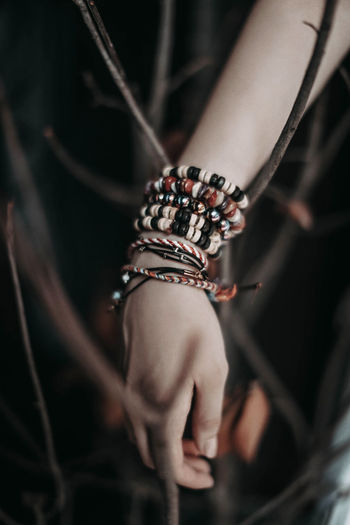 Female hand with jewelry and bracelets made of wooden beads