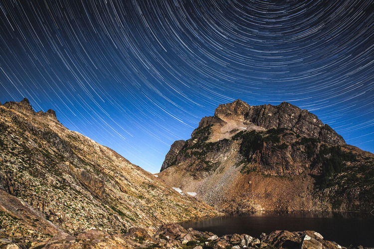 Astronomy Star - Space Space Scenics - Nature Mountain Beauty In Nature Long Exposure Night Sky Star Trail Nature Tranquility Environment Mountain Range Landscape No People Rock Tranquil Scene Solid Rock - Object