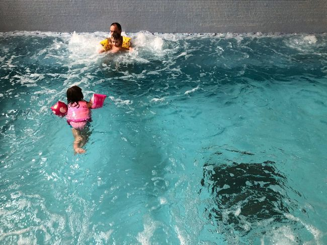 Real People Childhood Water Leisure Activity Boys Girls Togetherness Full Length Fun Swimming Pool Child Elementary Age Enjoyment Outdoors Lifestyles High Angle View Vacations Day Swimming