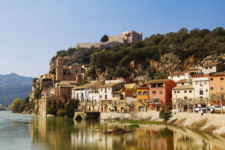 Buildings Reflecting On Ebro River