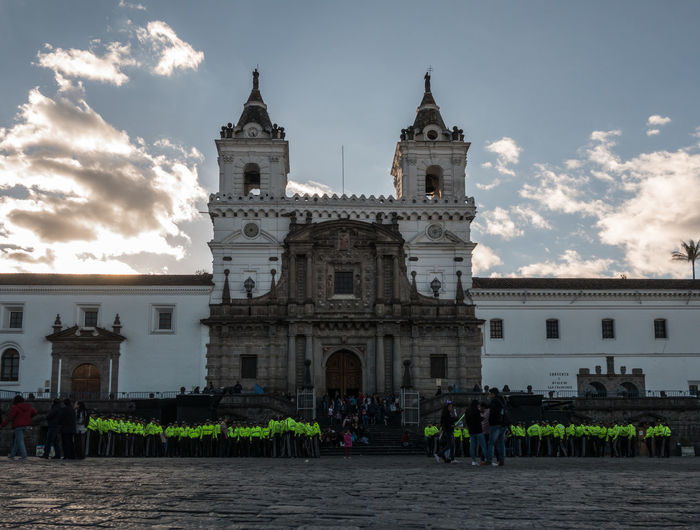 QUITO, ECUADOR - AUGUST 10, 2018: Police stand in front of the Church and Plaza de San Francisco prior to an evening event to celebrate Ecuador's Independence. Celebration Church And Monastery Of St. Francis Church And Plaza De San Francisco Downtown Event Holiday Iglesia Y Convento De San Francisco Independence Old Town Quito Traveling Architecture Building Building Exterior Built Structure City Ecuador Group Of People Independence Day Large Group Of People People Policia Real People Sky
