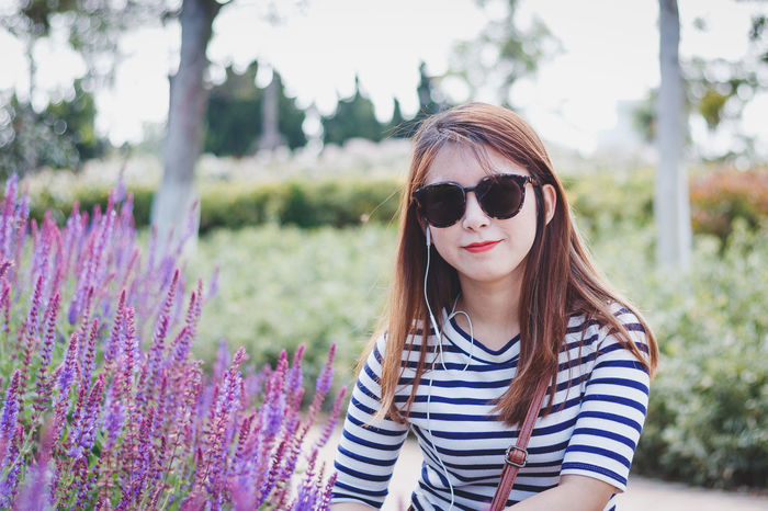 My friend Ms.Z Squat Beautiful Woman Casual Clothing Day Flower Lavender Lifestyles Long Hair One Person Outdoors Striped Sunglasses Young Women