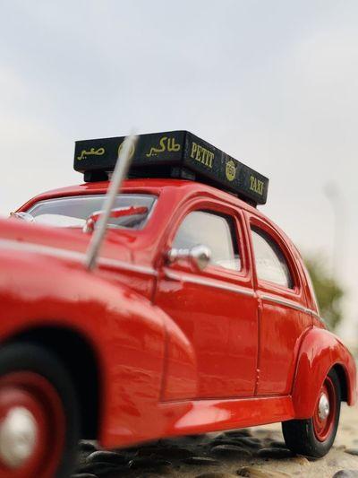 Close-up of vintage car on road against sky