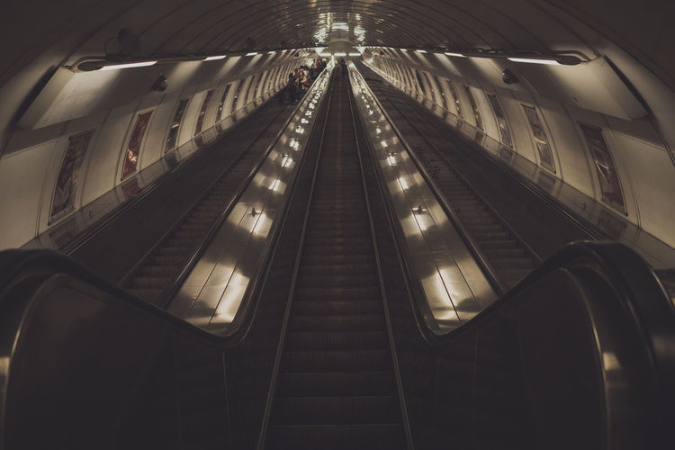 Empty escalators in modern building