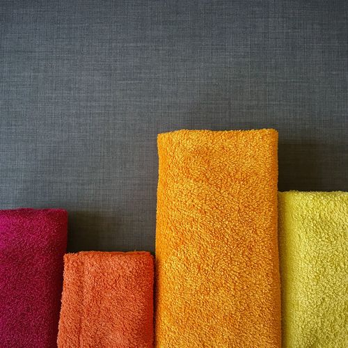 colorful towels. Backgrounds Burgundy Close-up Dark Red  Day Daylight Grey Indoor Indoor Photography IndoorPhotography Indoors  No People Orange Orange Color Red Textile Textiles Texture Textured  Top Perspective Towel Towelday Towels Yellow Yellow Color