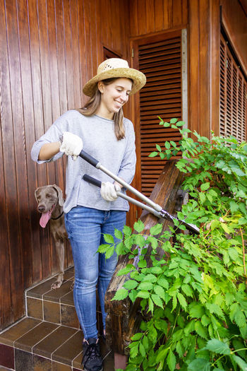 Woman cutting plants in yard