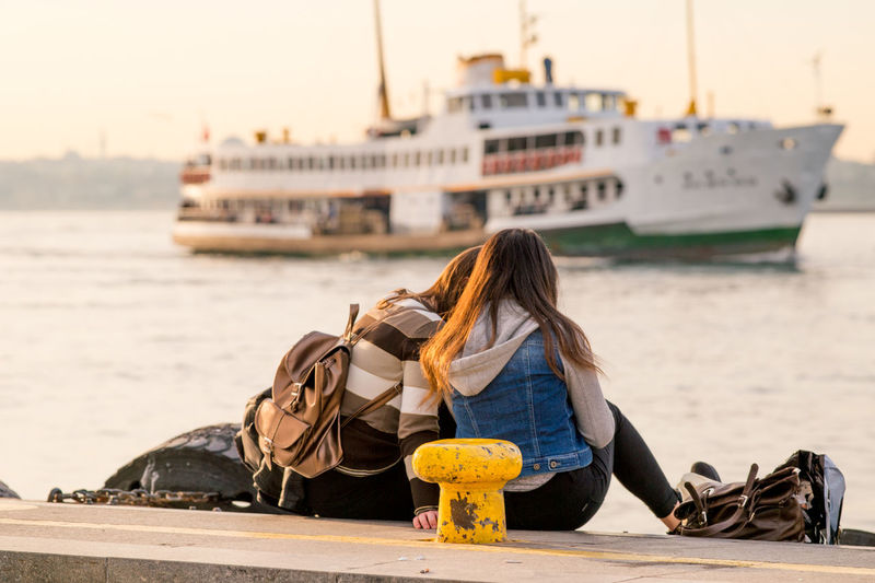 Couple enjoying Spring weather and a ferry passing by in the distance. Adventure Boat Bokeh Couple Ferry Ferryboat Focus On Foreground Istanbul Istanbul Turkey Istanbullovers Leisure Activity Lifestyles Natanomalous Natanomalous.com Nautical Vessel Rear View Sea Original Experiences Seascape Seascapes Seaside Sitting Travel Urban Spring Fever Two Is Better Than One Moments Of Happiness