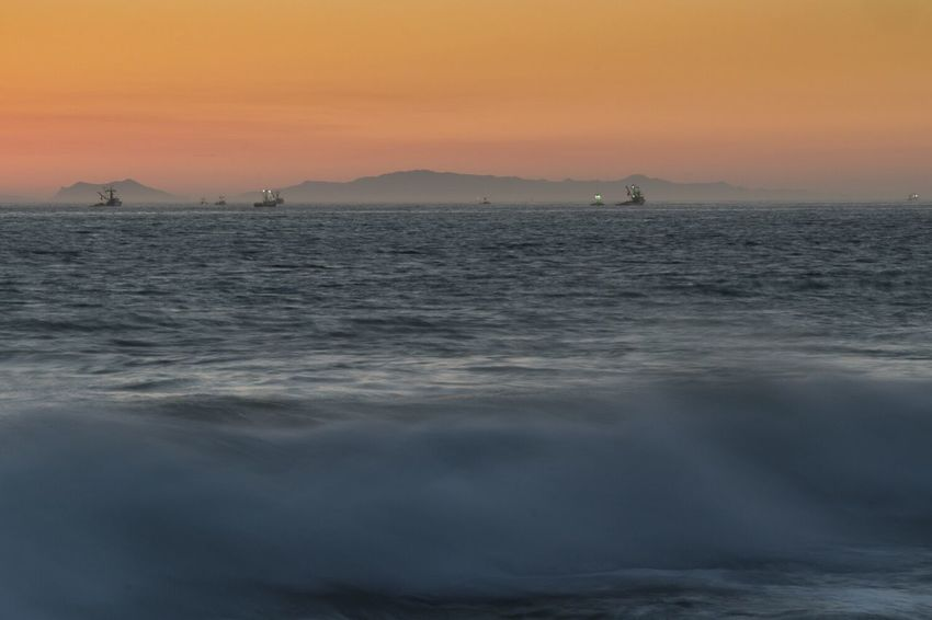 Fishing Boat off the coast of Point Mugu State Park at Sunset