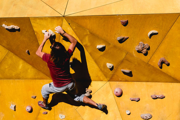 Rear view of woman on climbing wall