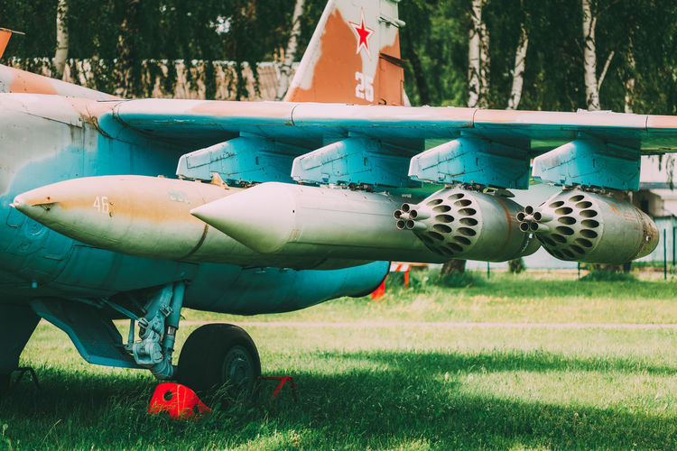 Chassis And Suspension Of Military Weapons On Pylon Of Soviet Russian Military Fighter Or Bomber. Suspension Aerodrome Airbase Aircraft Airdrome Airfield Airplane Army Attack Aviation Bomber Bulletproof Chassis Detail Ground Military Plane Pylon Soviet Transport Transportation Union Universal Ussr Weapon