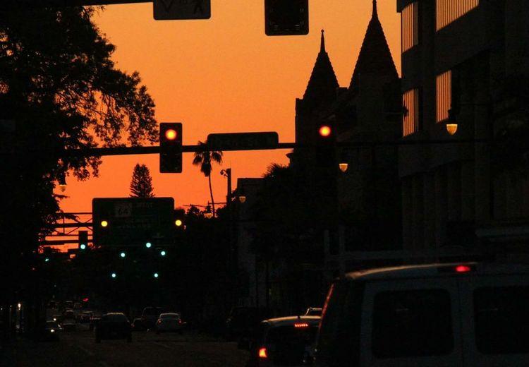 Sunset in downtown Bradenton Sunset Downtown Bradenton FL Orange Sky Manatee Avenue Red Light District Red Lights