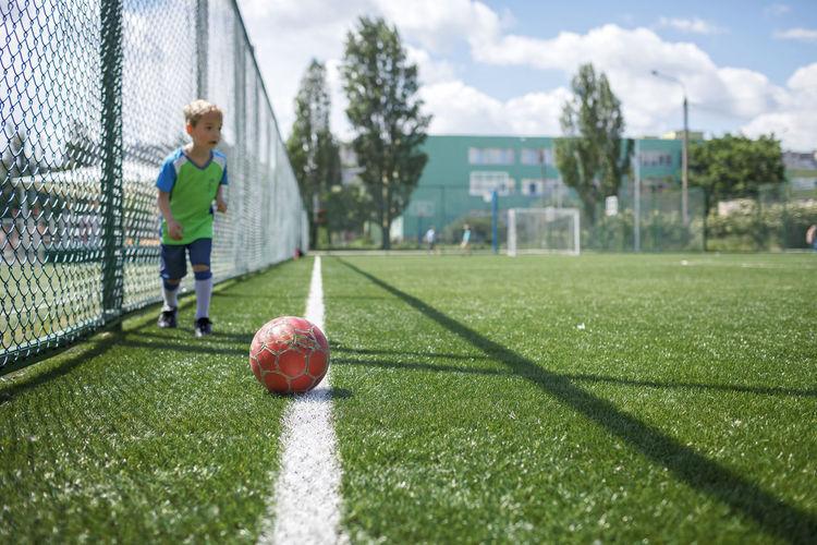 Man playing soccer ball on field