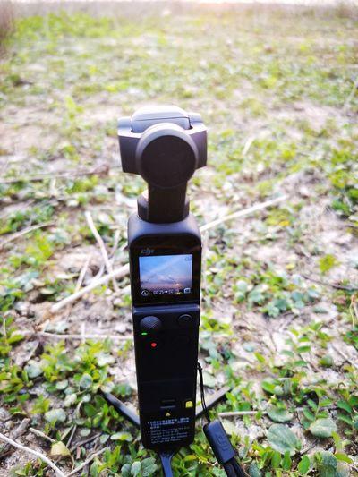Close-up of digital camera on field