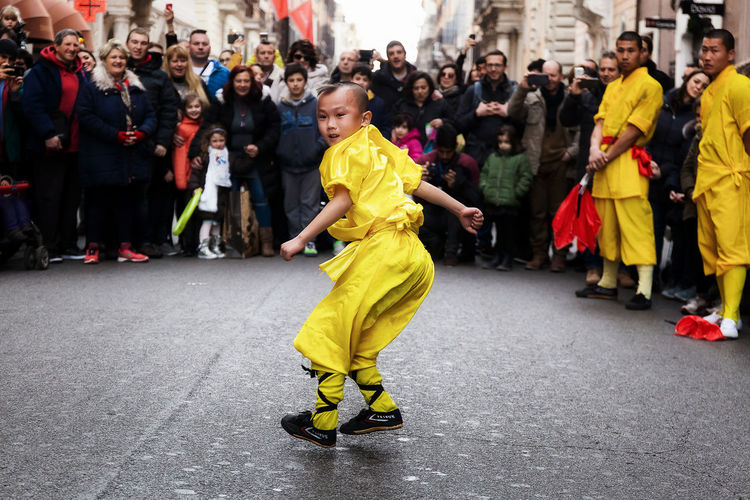 Rome, Italy - January 28, 2017: Chinese New Year 2017, the year of the rooster. Performance in Chinese martial arts very young child Arts Culture And Entertainment Child Chinese New Year 2017 Crowd Dancing Day Headwear Large Group Of People Lifestyles Martial Arts Material Ar Outdoors Participant People