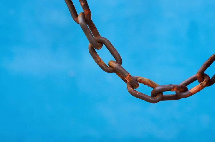 Close up of heavy chain against wistful blue background Chain Heavy Industrial Urban Colour Of Life Pivotal Ideas Oppression Blue Pastel Close-up Abstract Chained Colour Your Horizn