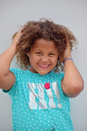 Dance Dancing Dance Childhood Child Smiling Front View One Person Looking At Camera Girls Casual Clothing Happiness Leisure Activity Women Curly Hair Innocence Indoors  Emotion Real People Portrait Waist Up Females Hair