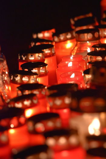 Cemetery Abundance Burning Candle Cemetary Close-up Decoration Defocused Food Food And Drink Glowing Heat - Temperature Illuminated In A Row Indoors  Large Group Of Objects Lighting Equipment Multi Colored Night No People Selective Focus Still Life