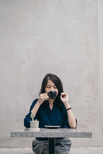 drink cappuccino Drink Cappuccino Portrait Women Beautiful Woman Looking At Camera Front View Holding Copy Space Black Hair Coffee Frothy Drink Froth Tea - Hot Drink International Women's Day 2019
