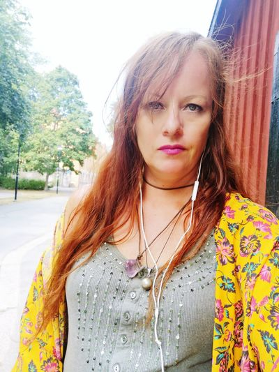 Hippie Stockholm Södermalm Sweden Summer 40 Something Woman Redhead Depression - Sadness Dark Vegetarian Flower Power Vacations Sad Portrait Beautiful Woman Looking At Camera Front View Close-up Casual Clothing Necklace Thoughtful Tensed Dyed Red Hair Freckle Jewelry Bead
