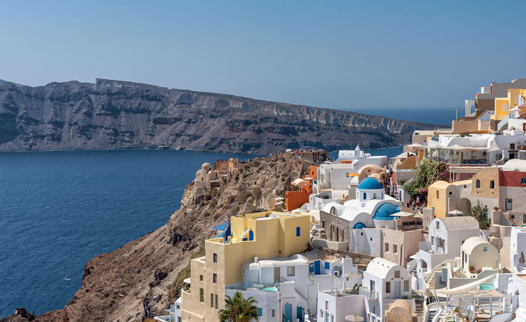 Oia - Santorini Cyclades Island - Aegean sea - Greece Santorini Greece Cyclades Mediterranean  Aegean Island Rock Oia Oia Santorini Village Luxury Architecture Building Exterior Built Structure City Building Residential District Sea Mountain Town High Angle View Sunlight House Cityscape TOWNSCAPE